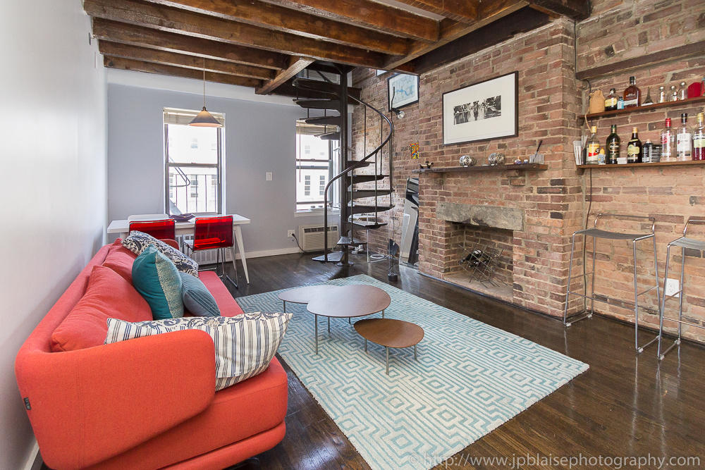 Professional picture of the living room of a Beautiful East Village duplex One Bedroom apartment
