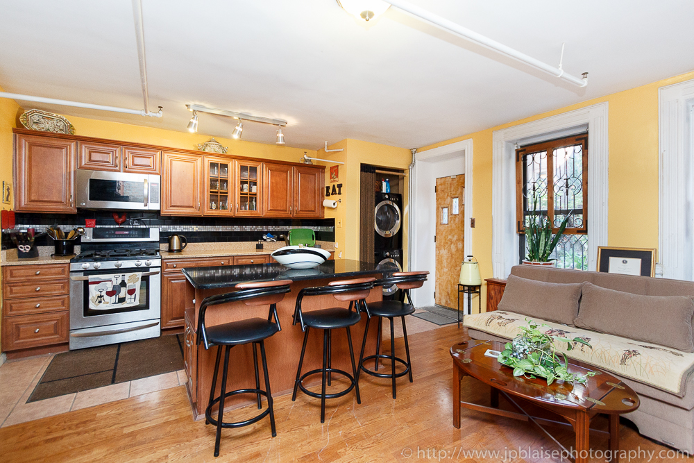 Real Estate photography of the kitchen of a New York City one bedroom garden apartment (Harlem)