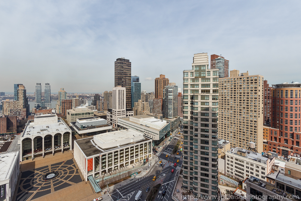 Interior photographer work view of the metropolitan opera and the manhattan skyline from Upper west side apartment