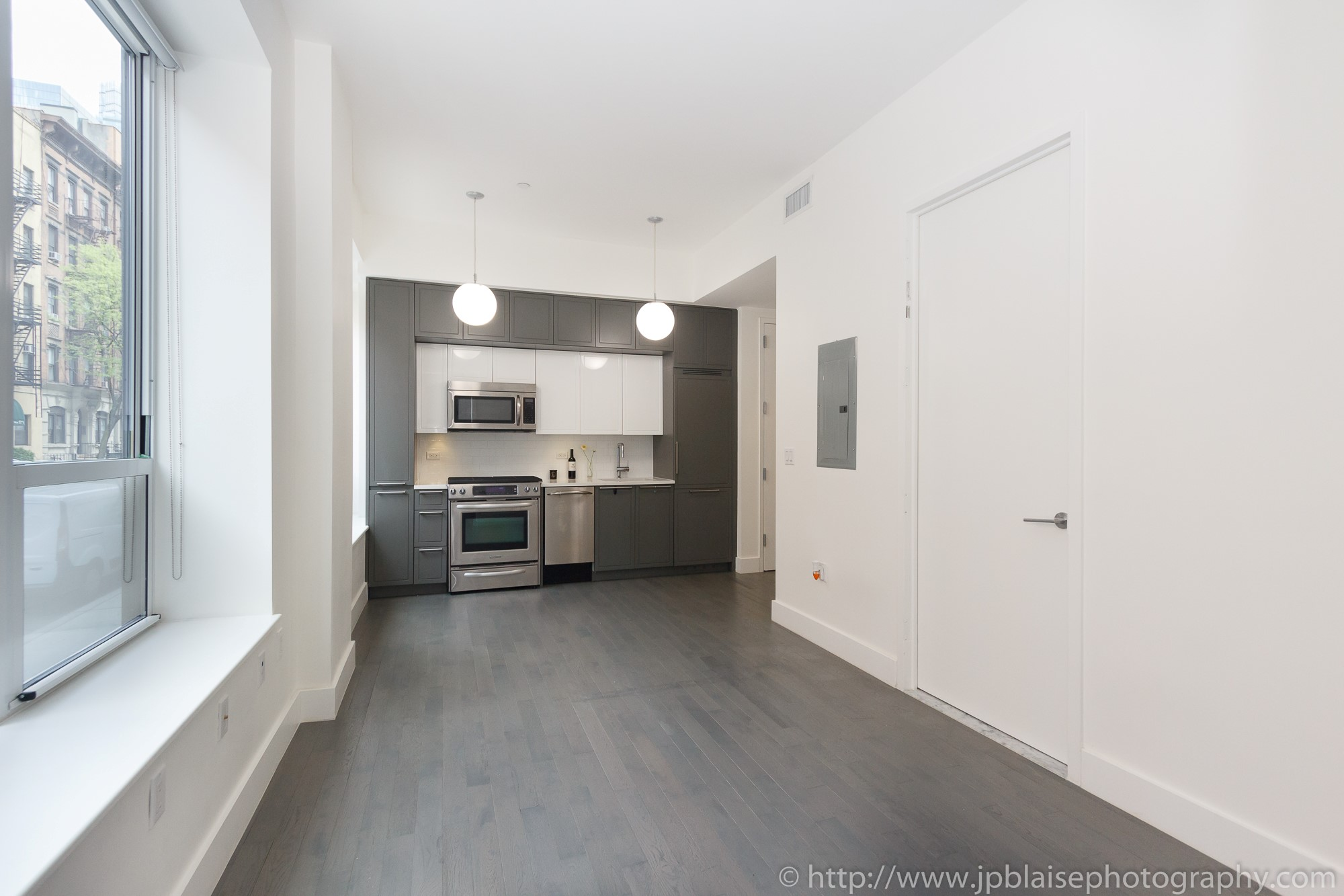 Real estate apartment photographer Midtown west 1 bedroom unit living room