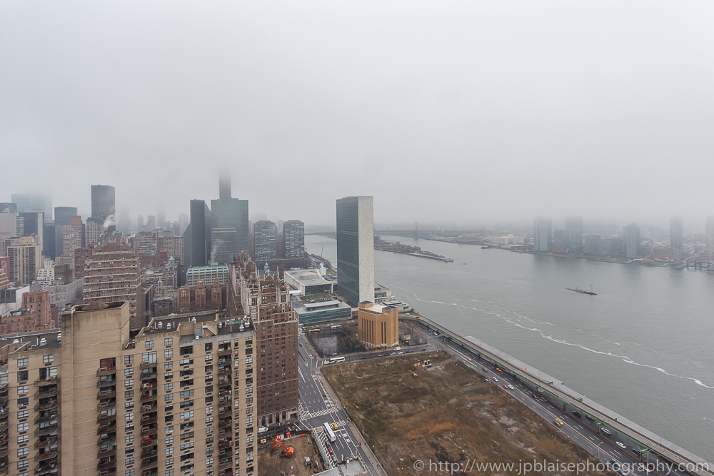 East river views on a foggy day from Midtown East Unit New York