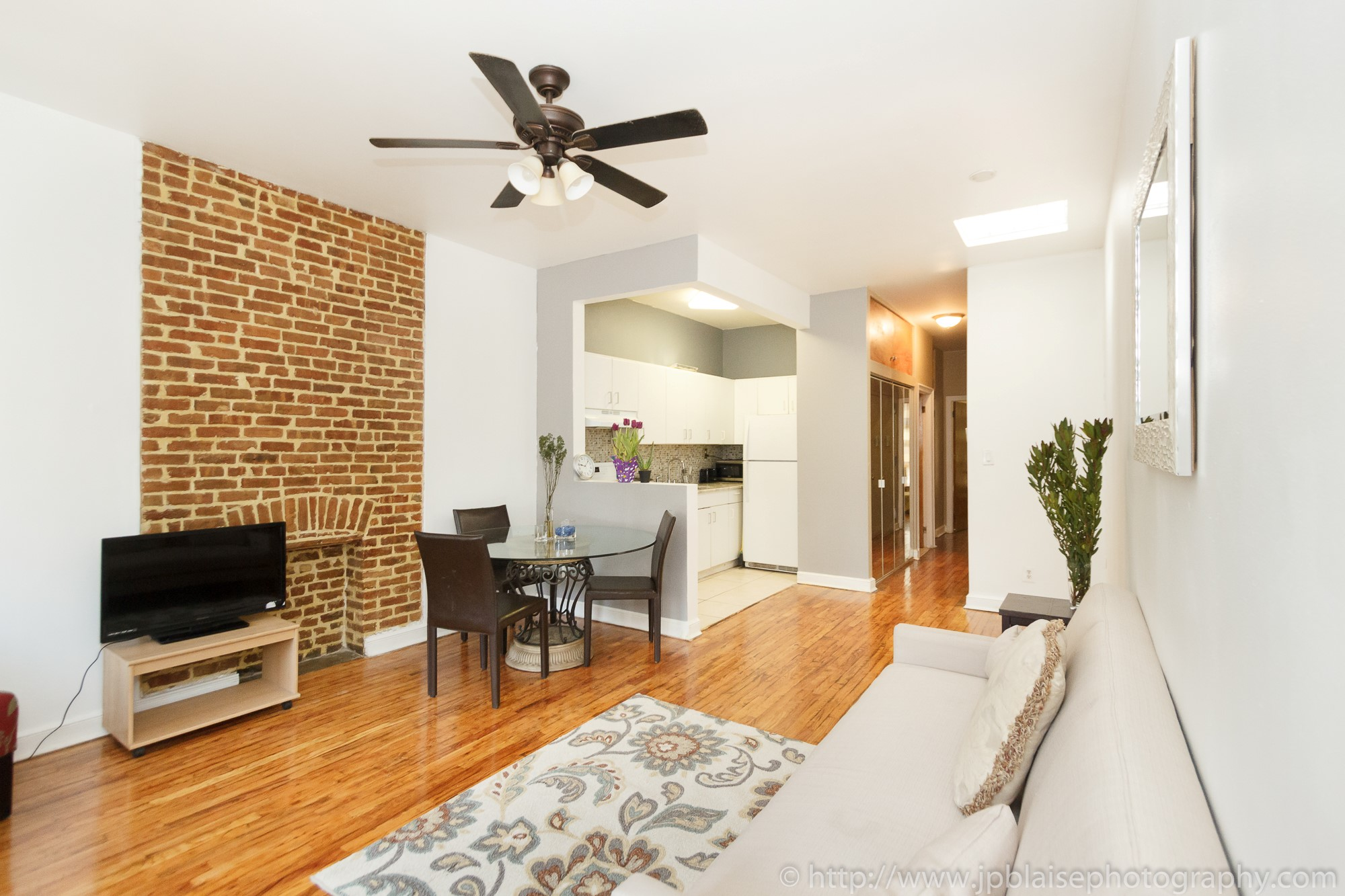 new york city real estate photographer one bedroom harlem living room